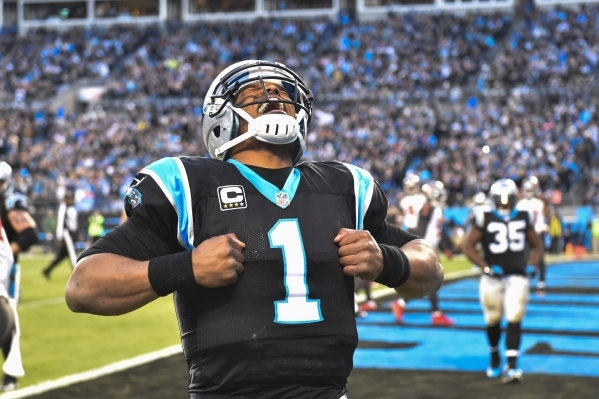 Jan 3, 2016; Charlotte, NC, USA; Carolina Panthers quarterback Cam Newton (1) reacts after scoring a touchdown in the second quarter at Bank of America Stadium. Mandatory Credit: Bob Donnan-USA TO ...