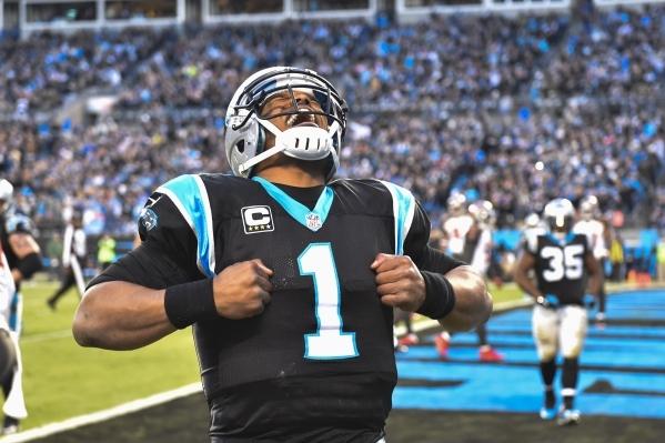 Jan 3, 2016; Charlotte, NC, USA; Carolina Panthers quarterback Cam Newton (1) reacts after scoring a touchdown in the second quarter at Bank of America Stadium. Mandatory Credit: Bob Donnan-USA TO ...