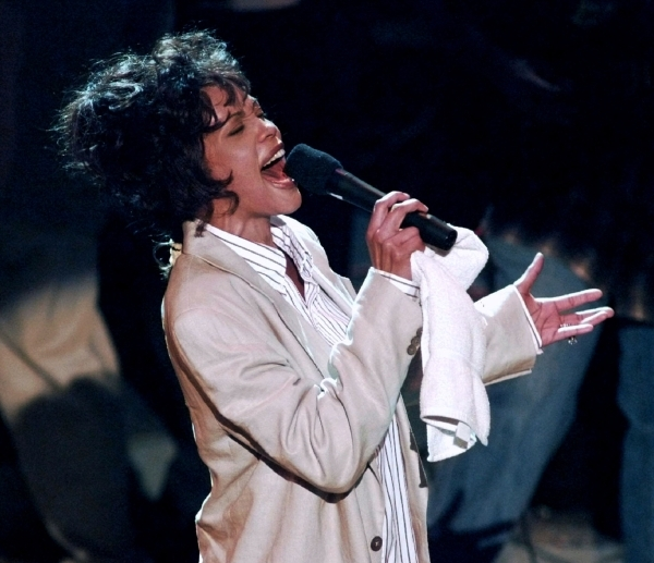 Singer Whitney Houston sings during a rehearsal for the 38th Grammy Awards at the Shrine Auditorium February 27. The Grammy Awards will be presented February 28. **DIGITAL IMAGE - RTXGY6W