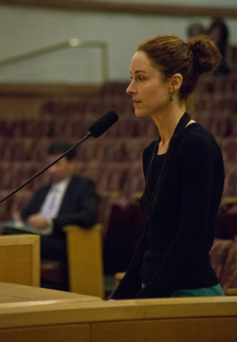 Elizabeth Oreck, the national manager of the Best Friends Animal Society, speaks out in favor of an ordinance that would prohibit the sale of certain animals during a Clark County Commission meeti ...