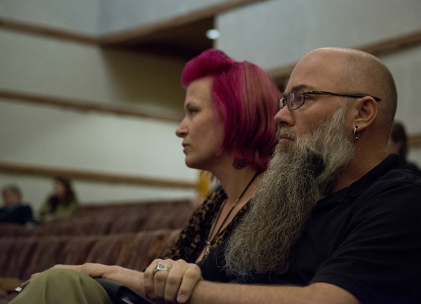 Joshua Cowart and Trish Savannahs sit in the audience after speaking against an ordinance that would prohibit the sale of certain animals during a Clark County Commission meeting in the Clark Coun ...