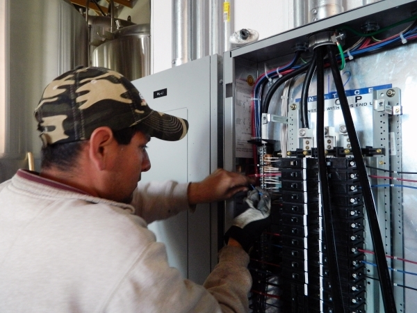 A Murphy Electric Inc. employee works on wiring at Lovelady Brewing Co., 20 S. Water St. The family-run business is set to include a tap house with large windows overlooking Water Street. Cassandr ...