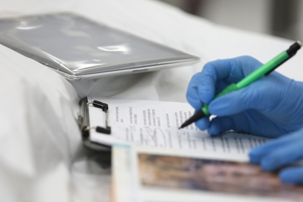 A tablet is shown near a student in a gross anatomy lab at Touro University Nevada Tuesday, Feb. 2, 2016, in Henderson. The classroom tablets are covered in clear sleeves to keep them clean. Stude ...