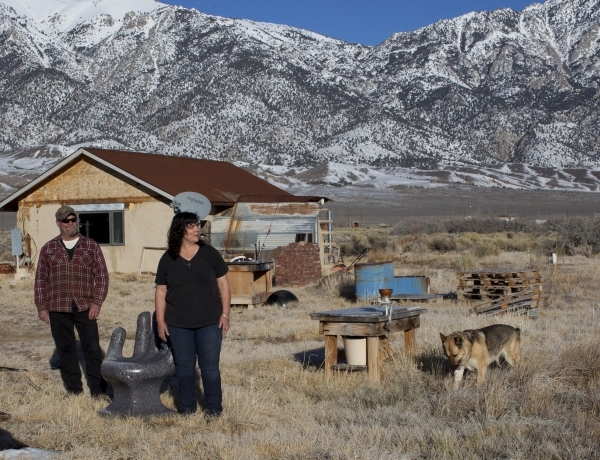 Kim Bozarth, right, and Jesse Johnson, stand in front of their straw bale house in Big Smoky Valley, Nev. on Thursday, Jan. 28, 2016. Bozarth left her urban life in Reno to build an all-natural ho ...