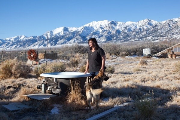 Kim Bozarth, poses on her property in Big Smoky Valley, Nev. on Thursday, Jan. 28, 2016. Bozarth left her urban life in Reno to build an all-natural house in this sweeping valley surrounded by maj ...