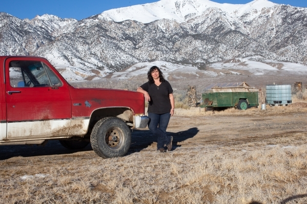 Kim Bozarth, poses with her 1986 Chevy Custom Deluxe Half Ton 4 Wheel Drive pickup on her property in Big Smoky Valley, Nev. on Thursday, Jan. 28, 2016. Bozarth left her urban life in Reno to buil ...