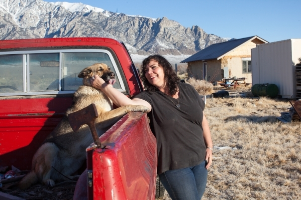 Kim Bozarth, pets her dog Ava on her property in Big Smoky Valley, Nev. on Thursday, Jan. 28, 2016. Bozarth left her urban life in Reno to build an all-natural house in this sweeping valley surrou ...
