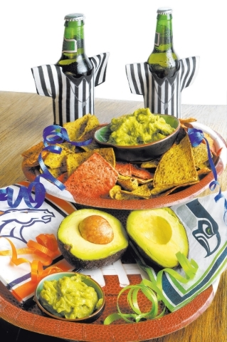 Beauty shot of guacamole, avocados, chips and props to go with a NFL Super Bowl XLVIII food story on avocados/guacamole. Photographed in studio on Sunday, Jan. 26, 2014. (Jeferson Applegate/Las Ve ...
