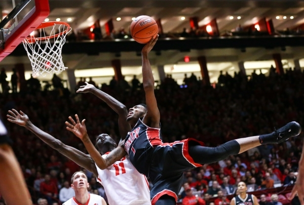 UNLV forward Derrick Jones Jr. (1) goes in for a layup to score against New Mexico center Obij Aget (11) during a basketball game at WisePies Arena in Albuquerque on Tuesday, Feb. 2, 2016. Chase S ...