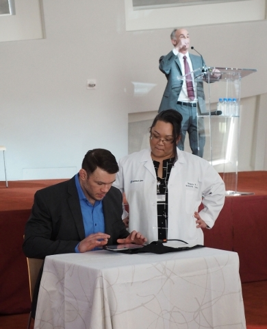 Ultimate Fighting Championship former champion Forest Griffin demonstrates a brain test as Dr. Charles Bernick speaks about a $1 million UFC grant to the Lou Ruvo Center for Brain Health in Las Ve ...