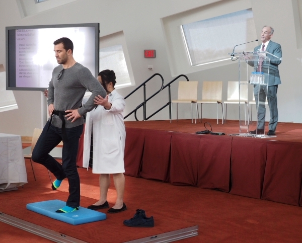 Ultimate Fighting Championship middle weight champ Luke Rockhold demonstrates a balance test during an event announcing a $1 million donation by the UFC at the Lou Ruvo Center for Brain Health in  ...