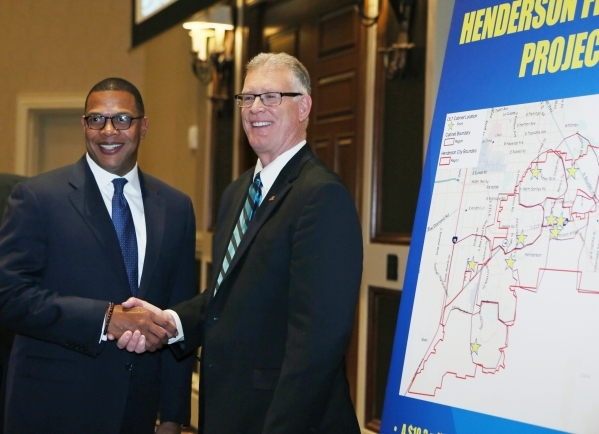 Henderson Mayor Andy Hafen, right, shakes hands with Derrick Hill, vice president of Cox Business and Hospitality Network, after the mayor delivered the annual State of the City address at Green V ...