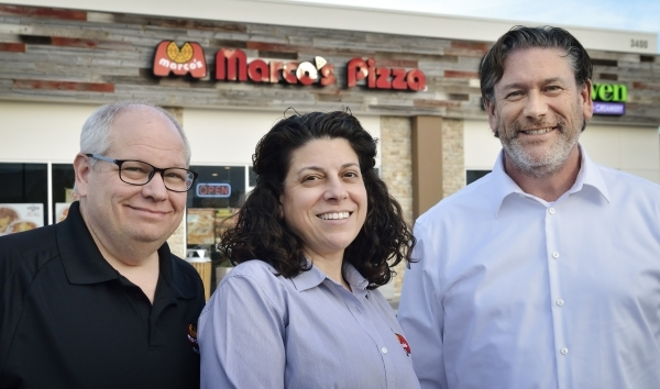 Bryon Stephens, president and chief operating officer at MarcoþÄôs Pizza, who was also featured on þÄúUndercover BossþÄù on CBS, right, is shown with franchisees and are ...