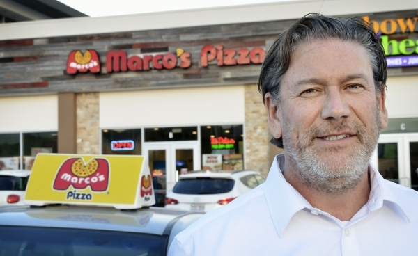 Bryon Stephens, president and chief operating officer at MarcoþÄôs Pizza, who was also featured on þÄúUndercover BossþÄù on CBS, is shown at one of the companyþÄà ...