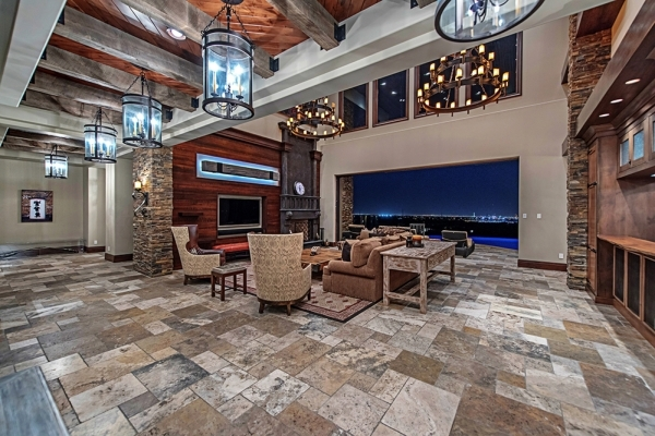 The great room boasts a high-vaulted ceiling made of slated hardwood and a large reclaimed wooden beam. The focal point of the room is a 20-foot wide pocket glass door that opens seamlessly into t ...