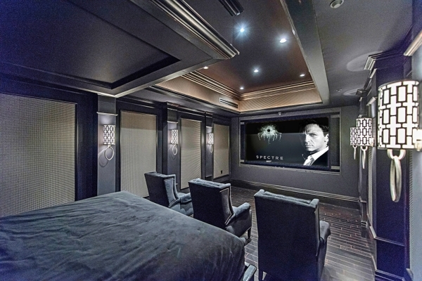 The 10,500-square-foot home has a home theater with a 10-foot screen television encompassing the entire east wall. The large screen projects crisp detail with ultra 4-K high definition — the hig ...