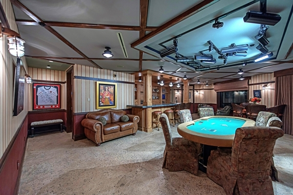 On the lower level, is a dedicated game room that is modeled after an Irish pub in Amsterdam and includes a full bar with a double tap system. In the middle of the room, a World Series of Poker ta ...