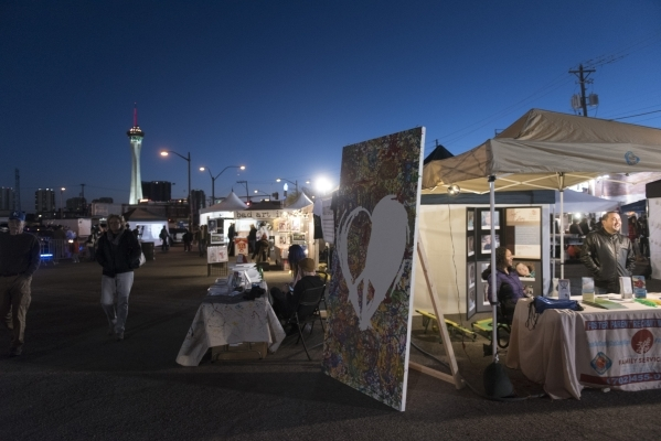 Vendors and patrons enjoy the First Friday arts festival in downtown Las Vegas' 18b Arts District Friday, Feb. 5, 2016. The festival resumed after several months off to reorganize. Jason Ogu ...