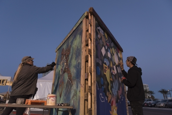 Kimberly Johnson, left, and Robert Harp work on their Guerrilla Kage art panels during the First Friday arts festival in downtown Las Vegas' 18b Arts District Friday, Feb. 5, 2016. Jason Ogu ...