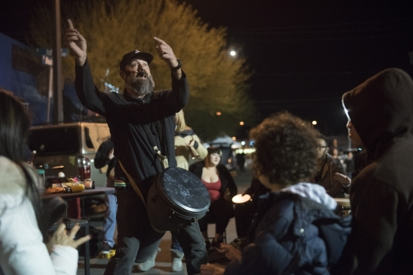 Jeffrey Trower of Community Productions, left, leads a drum circle during the First Friday arts festival in downtown Las Vegas' 18b Arts District Friday, Feb. 5, 2016. The festival resumed a ...