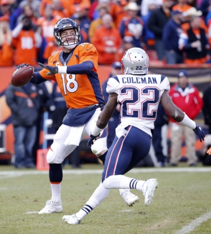 Jan 24, 2016; Denver, CO, USA; Denver Broncos quarterback Peyton Manning (18) throws a pass against New England Patriots cornerback Justin Coleman (22) in the third quarter in the AFC Championship ...