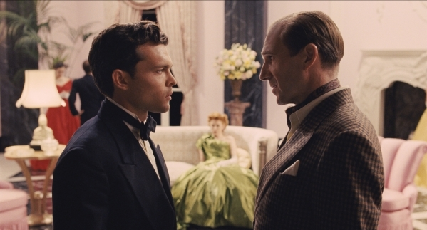 "Rising star Hobie Doyle (Alden Ehrenreich), left, speaks with director Laurence Laurentz (Ralph Fiennes) in ""Hail, Caesar!"" an all-star comedy from Joel and Ethan Coen. (Universal Pictures)"