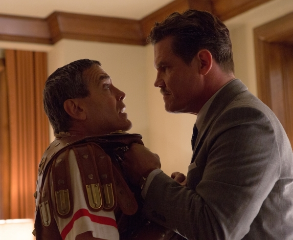 "Baird Whitlock (George Clooney), left, is set straight by Eddie Mannix (Josh Brolin) in ""Hail, Caesar!"" an all-star comedy from Joel and Ethan Coen. (Alison Rosa/Universal Pictures)"