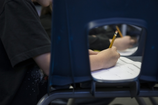 A student completes an assignment during class at Lomie Heard Elementary School classroom inside Nellis Air Force Base on Tuesday, Feb. 9, 2016, in Las Vegas. The school will close its doors at th ...