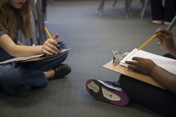 Students complete an assignment during class at Lomie Heard Elementary School classroom inside Nellis Air Force Base on Tuesday, Feb. 9, 2016, in Las Vegas. The school will close its doors at the  ...
