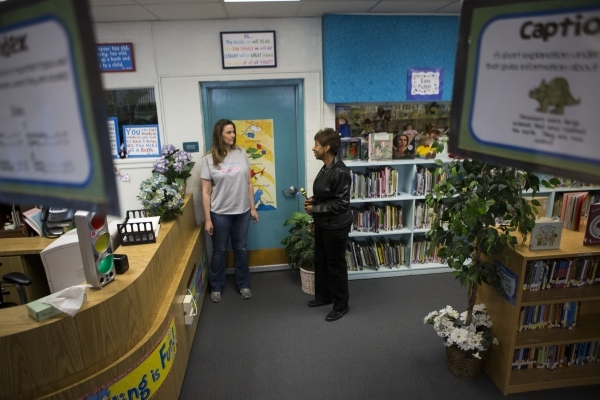 Librarian Stacy Moore, left, and Pamela Goynes-Brown, assistant principal at Lomie Heard Elementary School and North Las Vegas City Council member, gives a tour of Lomie Heard Elementary School in ...