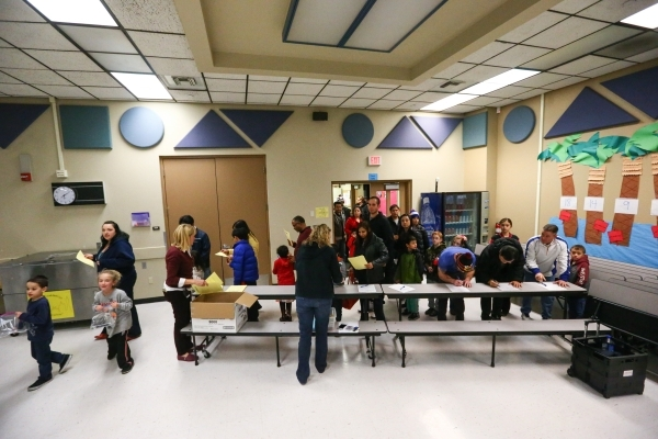 People arrive for family math and science night at Bendorf Elementary School in Las Vegas on Thursday, Feb. 4, 2016. The school is one of two in the entire state to receive the prestigious designa ...