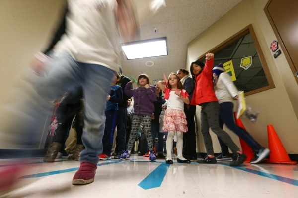 Children take part in a paper airplanes activity during family math and science night at Bendorf Elementary School in Las Vegas on Thursday, Feb. 4, 2016. The school is one of two in the entire st ...