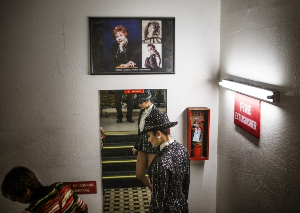 Jubilee dancer Dani Flahive walks pass a framed photo memorial of long time manager Fluff LeCoque  during a Jubilee Theater tour at Bally's, 3645 South Las Vegas Boulevard, on Wednesday, Feb ...