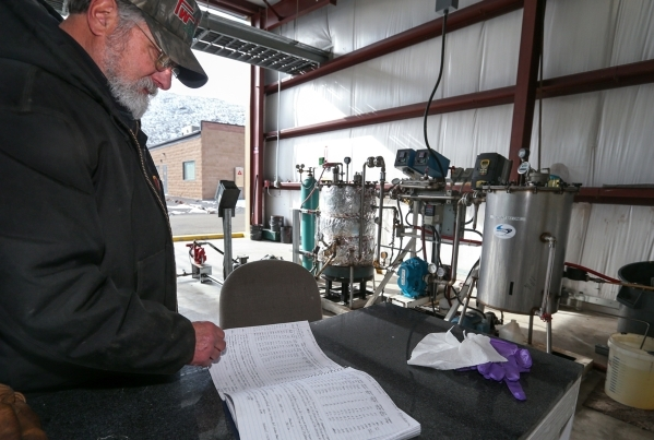 Chuck Bump, who heads research and development for Advanced Refining Concepts in the Tahoe-Reno Industrial Center near Sparks, Nev., looks through notes on tests of the refining process on Wednesd ...
