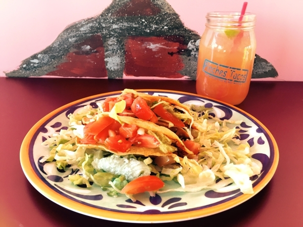 Gringo Tacos and a blood-orange margarita, as served at Pinches Tacos at The Grammercy. (Courtesy Pinches Tacos)