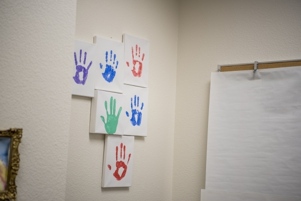 Hand prints of children that Alissa Cooley and Katelyn Leese have helped are seen in their office at the Thomas & Mack Legal Clinic on the campus of UNLV in Las Vegas on Monday, Feb. 8, 2016.  ...