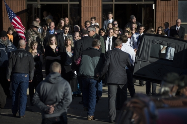 Family members of Robert LaVoy Finicum including his widow Jeanette Finicum, right, and daughter Brittney Beck, center, follow his casket to a hearse waiting outside of the Kanab Utah Kaibab Stake ...