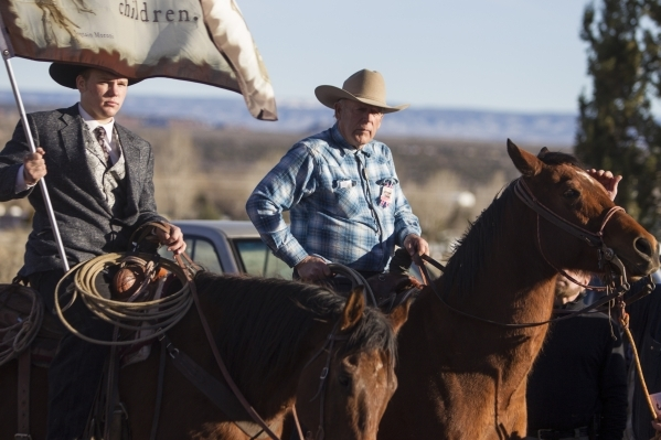 Bunkerville rancher Cliven Bundy, right, and his son Arden ride their horses following the funeral service for Robert LaVoy Finicum at the Kanab Utah Kaibab Stake Mormon church on Friday, Feb. 5,  ...
