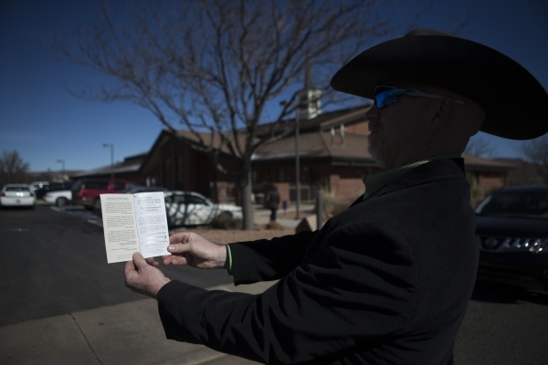 Todd Applegate shows a copy of the United States Constitution dedicated to Robert LaVoy Finicum while at his funeral at the Kanab Utah Kaibab Stake on Friday, Feb. 5, 2016, in Kanab, Utah. Erik Ve ...
