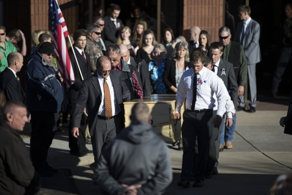 Robert LaVoy Finicum's casket is carried to a hearse waiting outside of the Kanab Utah Kaibab Stake Mormon church following his funeral on Friday, Feb. 5, 2016, in Kanab, Utah. Erik Verduzco ...
