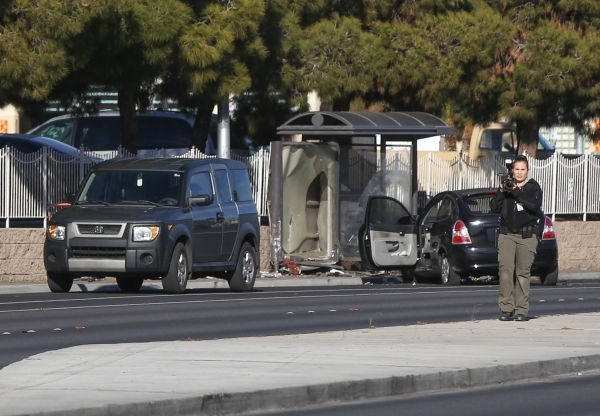 Las Vegas Police investigate a bus stop that a car crashed into on Lake Mead Boulevard west of Rancho Drive the won Thursday, Feb. 4, 2016 in Las Vegas. Brett Le Blanc/Las Vegas Review-Journal Fol ...
