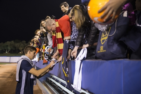 Los Angeles Galaxy's Steven Gerrard (8) signs autographs after his team's victory 1-0 against San Jose Earthquakes in their Major League Soccer pre-season game at Cashman Field on Satu ...