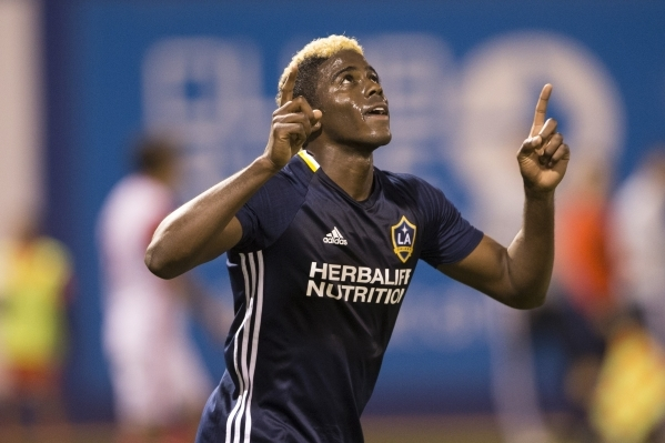 Los Angeles Galaxy's Gyasi Zardes (11) reacts after scoring against the San Jose Earthquakes in their Major League Soccer pre-season game at Cashman Field on Saturday, Feb. 13, 2016, in Las  ...