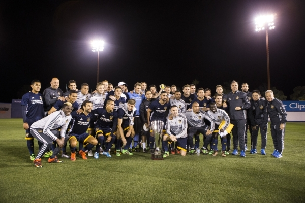 Los Angeles Galaxy's team pose for a photo with the California Clasico trophy after their win against San Jose Earthquakes in their Major League Soccer pre-season game at Cashman Field on Sa ...