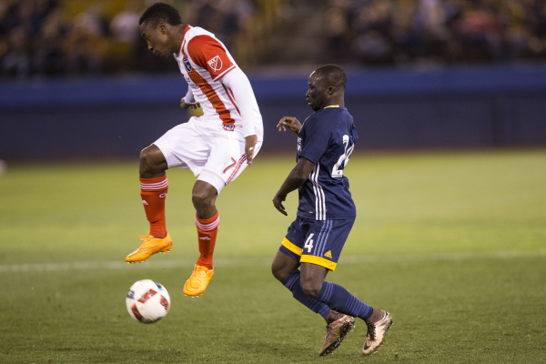 San Jose Earthquakes Cordell Cato, left, (7), fights for ball possession against Los Angeles Galaxy's Emmanuel Boateng (24) in their Major League Soccer pre-season game at Cashman Field on S ...