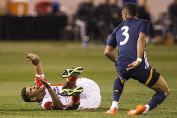 San Jose Earthquakes Anibal Godoy reacts (30) after getting tackled by Los Angeles Galaxy's Ashley Cole (3) in their Major League Soccer pre-season game at Cashman Field on Saturday, Feb. 13 ...