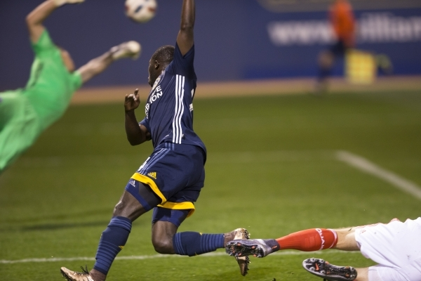 Los Angeles Galaxy's Emmanuel Boateng (24) looks at his kick to the goal against San Jose in their Major League Soccer pre-season game at Cashman Field on Saturday, Feb. 13, 2016, in Las Veg ...