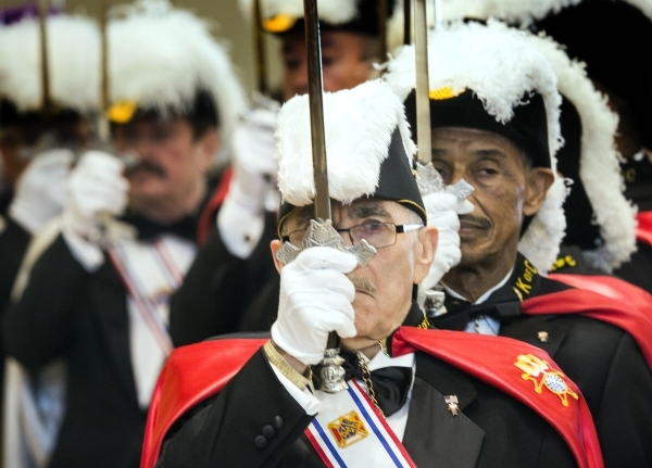 Knights of Columbus Senior Knight Andy Vallone stand to attention during the Entrance Procession at St. Anthony of Padua Roman Catholic Church, 6350 N. Fort  Apache Road, on Friday, Feb. 5, 2016.  ...