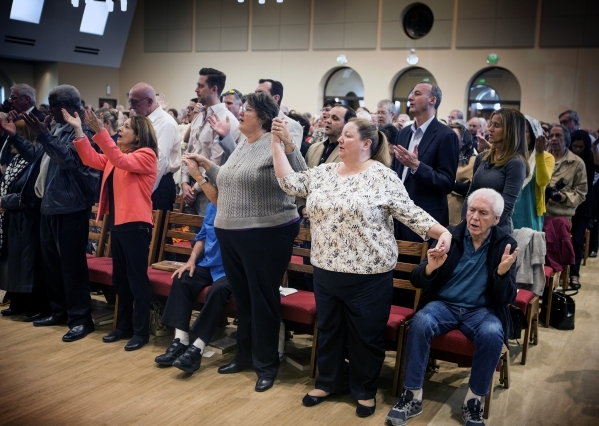 People gather to pray at St. Anthony of Padua Roman Catholic Church, 6350 N. Fort  Apache Road, on Friday, Feb. 5, 2016. The church celebrating its first Mass. and blessing. Jeff Scheid/Las Vegas  ...
