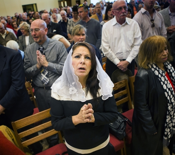 Rita Phillips prays at St. Anthony of Padua Roman Catholic Church, 6350 N. Fort  Apache Road, on Friday, Feb. 5, 2016. The church celebrating its first Mass. and blessing. Jeff Scheid/Las Vegas Re ...